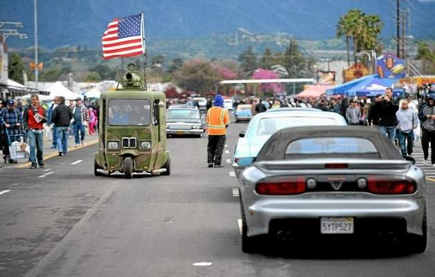 Customikes at Pomona Swap Meet 2015 Mikael Wallin, left, drives a 1962 Cushman Westcoaster down the main road during the Pomona Swap Meet and Classic Car Show on Sunday at Fairplex in Pomona. photos by micah escamilla — staff photographer