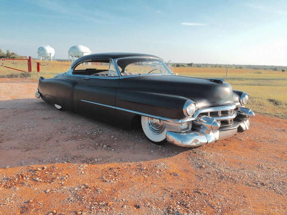 This bad bulbous black Caddy was shared by King Daddy Caddy - Cadillac of the day.