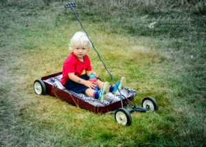Kid rides, radio flyer, wagons, slammed, fun, blond kid,